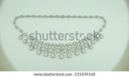 Necklace on white background - stock photo