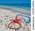 necklace, starfish and diving mask by the shore - stock photo