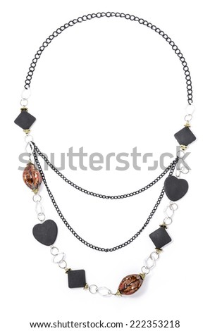 necklace with amber and onyx on a white background - stock photo