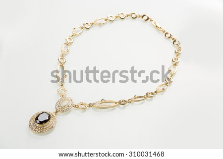 Necklace with black pearls on a white  - stock photo