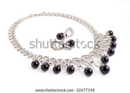 Necklace with black pearls on a white background - stock photo