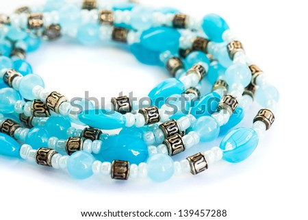 Necklace with blue stones isolated on white background. - stock photo