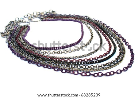 Necklace with colorful chains isolated on white background. - stock photo
