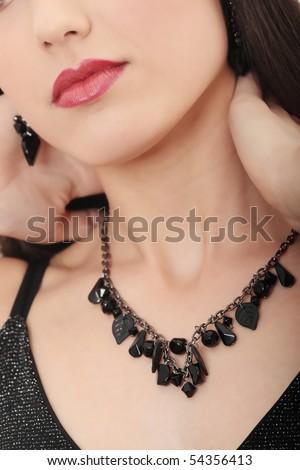Neckles on elegant woman neck - stock photo