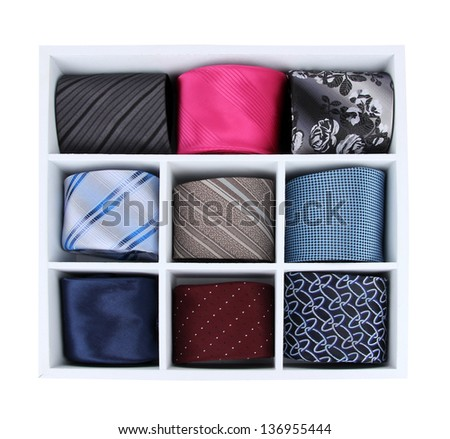 Neckties in wooden box isolated on white - stock photo