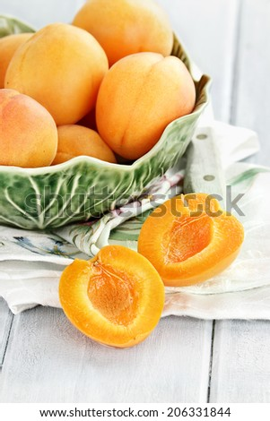 Nectarines in a pretty glass bowl. Extreme shallow depth of field with selective focus on sliced fruit. - stock photo