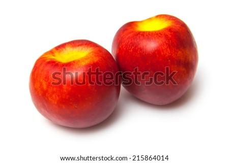 Nectarines isolated on a white studio background. - stock photo