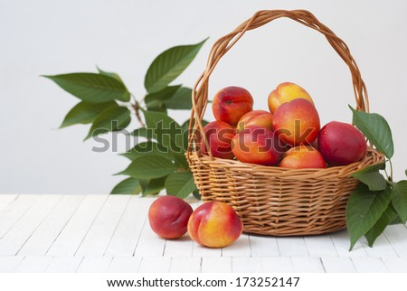 nectarines  on white wooden table