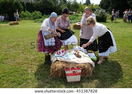 NEDELISCE, CROATIA - JULY 02, 2016: The harvest traditionally begins assembling villagers, singing and dancing and good food in Nedelisce, Croatia on July 02, 2016