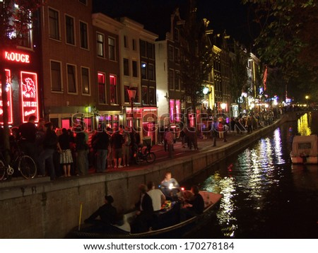 NEDERLAND, AMSTERDAM - CIRCA AUGUST 2007: Unknown people walk in the Red light district on August 2007 in Nederland, Amsterdam.