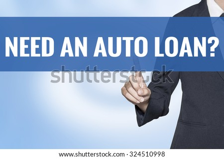 Need An Auto Loan word on virtual screen touch by business woman blue background - stock photo