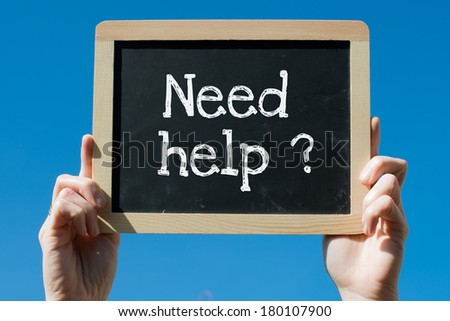 Need help ? on blackboard - stock photo