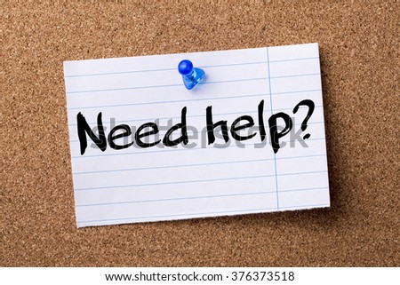 Need help? - teared note paper  pinned on bulletin board - horizontal image - stock photo