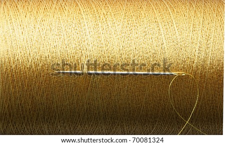 needle and golden thread. - stock photo