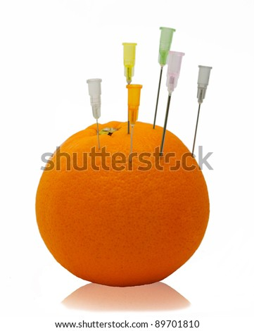 needle and orange - stock photo