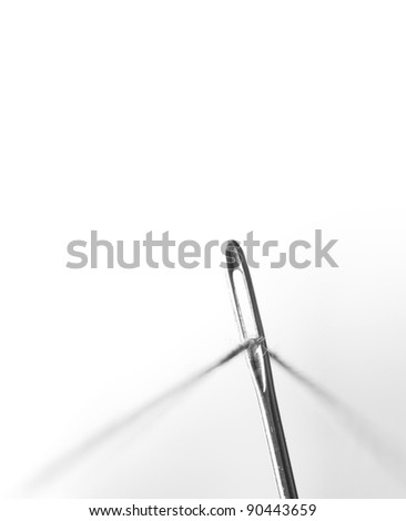 needle and thread.on white background - stock photo