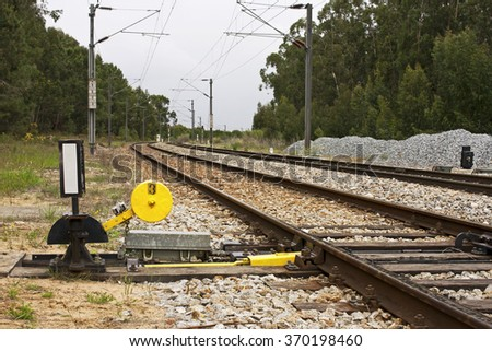 Needle chaging of train line in a rural environment - stock photo