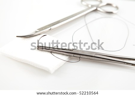 Needle Holders With Suture And Scissors - stock photo