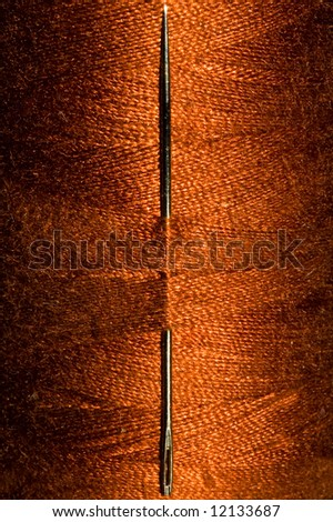 Needle in roll of thread - stock photo