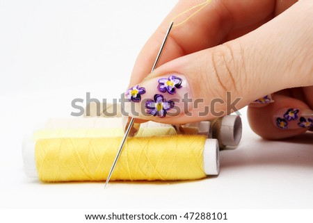 Needle in the yellow bobbin - stock photo