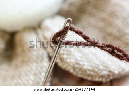 Needle lapped with thread (Focused on the needle) - stock photo