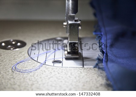 Needle Sewing machine and item clothing close up. - stock photo