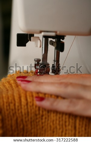 needle sewing machine and thread. work tailoring hobby