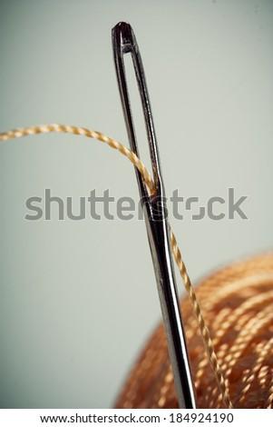 needle thread thimble vintage retro style - stock photo
