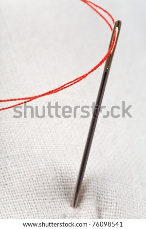 needle with red thread - stock photo