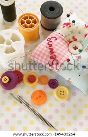 Needles and threads with a pin cushion - stock photo