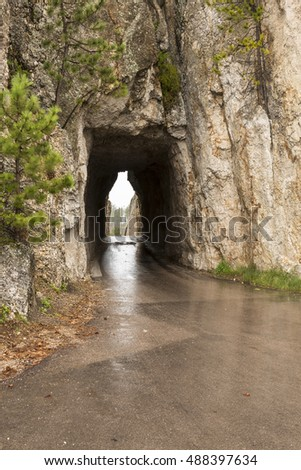 Needles Tunnel / A narrow tunnel on a road.