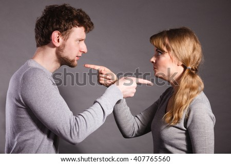 Negative emotions concept. People in fight. Husband and wife arguing and yelling on each other. Expressive and emotional couple having argument. - stock photo