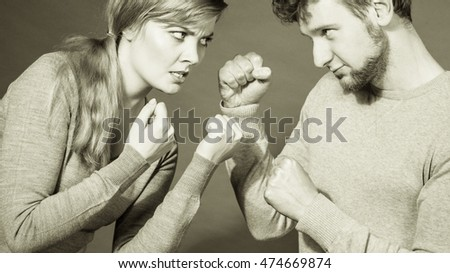 Negative emotions concept. People in fight. Husband and wife arguing and yelling on each other. Expressive and emotional couple having argument.