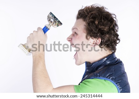 Negative funny man screaming angry with cup of victory - stock photo