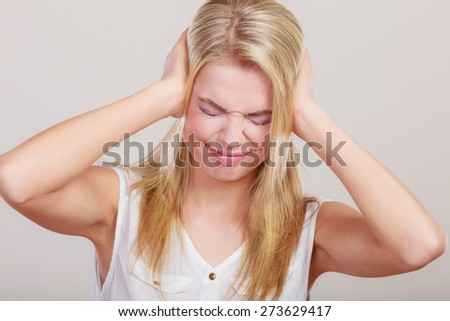 Negative human emotions, facial expressions, reaction attitude. Closeup stressed business woman covers ears with hands