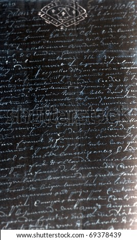 Negative image of an ancient manuscript, white writing on black paper - stock photo