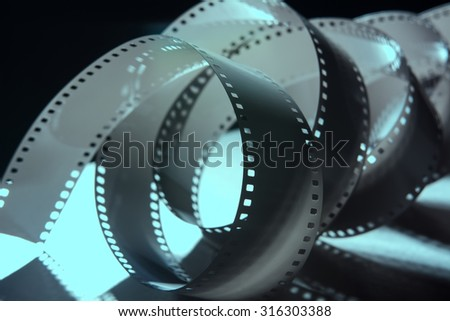 Negative 35 mm film. A roll of photographic film. - stock photo