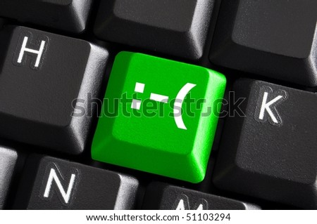 negative smilie on green computer keyboard button showing bad feelings concept - stock photo