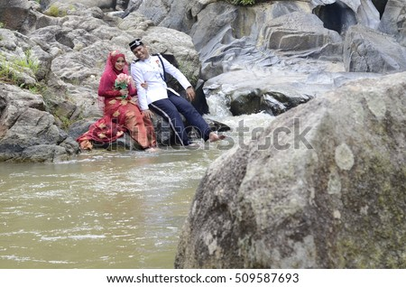 Negeri Sembilan, Malaysia - July  28,2016: Outdoor shooting for malay wedding, the bride  wearing Negeri Sembilan traditional cloth and groom wearing casual style. ( soft focus effect)