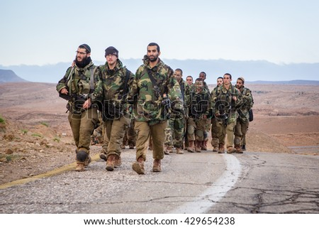 Negev Desert, Israel - February 16, 2015: Soldiers from the IDF Nahal Brigade march across the Negev Desert as a part a 50km march to finalize their advanced training.
