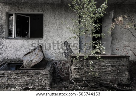 Neglected child. Atmosphere of deep depression, fear and abandonment. Autumn in dead city. Fall. Ruins if old building. Fear, emptiness, despair. Desperate child. Ruins of Pripyat. Chernobyl zone.
