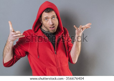 negligence concept - bored 40s man expressing careless responsibility for mistake,studio shot - stock photo
