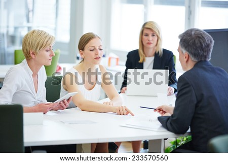 Negotiation in business team meeting in the office - stock photo