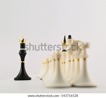 Negotiations concept as black chess king figure opposite to the white ones composition - stock photo