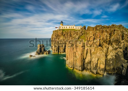 Neist Point lighthouse at Isle of Skye, Scottish highlands, United Kingdom. Long exposure - stock photo