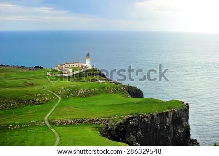 Neist point lighthouse on the Isle of Skye on beauty summer day - stock photo