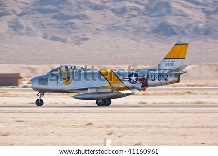 NELLIS AFB, LAS VEGAS, NV - NOVEMBER 14: North American F-86F Sabre Cold war-era fighter jet aircraft landing after performing at Aviation Nation 2009, November 14, 2009, Nellis AFB, Las Vegas, NV