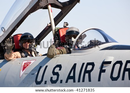 NELLIS AFB, LAS VEGAS, NV - NOVEMBER 14: T-33 Shooting Star pilots greet spectators at Aviation Nation 2009 on November 14, 2009 in Nellis AFB, Las Vegas, NV. - stock photo