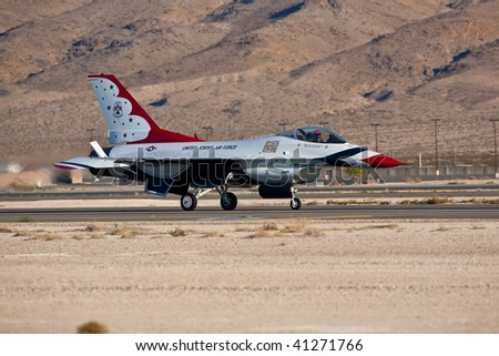 NELLIS AFB, LAS VEGAS, NV - NOVEMBER 14: USAF Thunderbirds air demonstration squadron aircraft landing after performing at Aviation Nation 2009 on November 14, 2009 in Nellis AFB, Las Vegas, NV.
