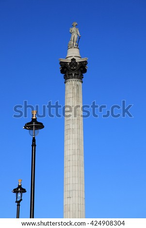 Nelsonâ??s Column monument rises to nearly 185 feet in the centre of Trafalgar Square London England it was erected to celebrate Horatio Nelson's victory at Trafalgar over Napoleon in 1805